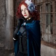 Gothic redhead woman walking with candle - Lizenzfreies Foto