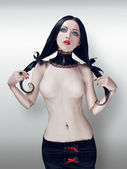Ball-jointed doll met pigtails — Stockfoto