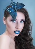 Studio beauty portrait with blue butterfly — Stock Photo