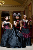 Three gothic girls with horns — Stock Photo