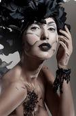 Creative beauty shot with headdress — Stock Photo