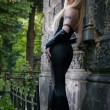 Gothic blond woman in black dress - Stock fotografie