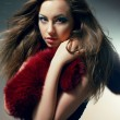 Young woman in black dress with red boa - Foto Stock