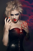 Portrait of young gothic girl with red lips and nails — Stockfoto