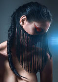 Dark portrait with black fringe on face — Stock Photo