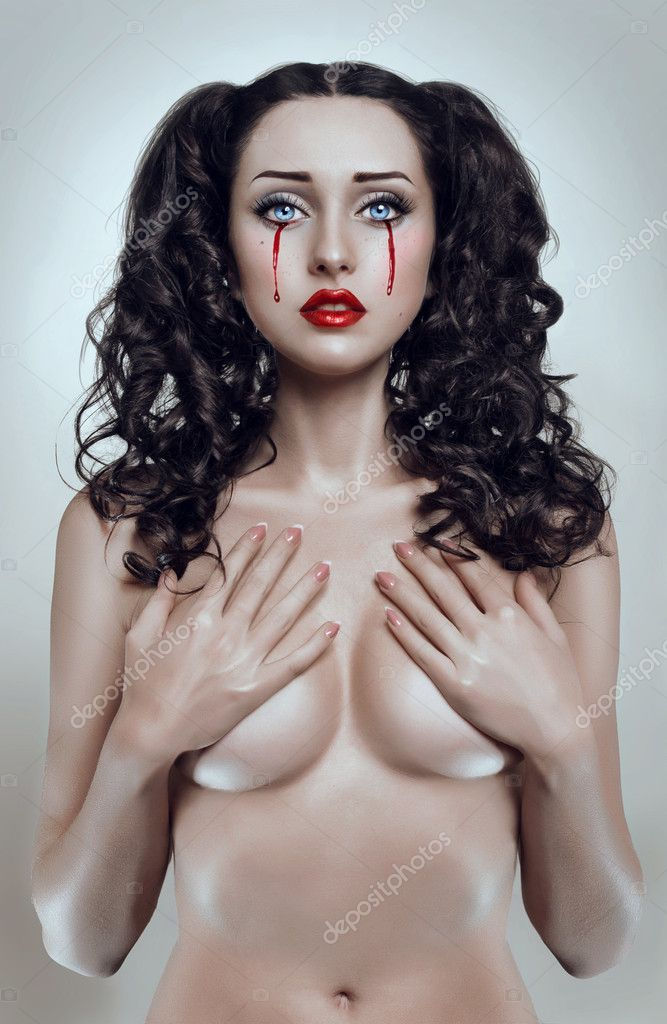 Beautiful brunette bleeding woman  Stock Photo #10339205