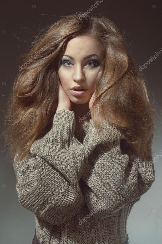 Young woman with beautiful long hair  in knitted  gray sweater — Stock Photo #10339709