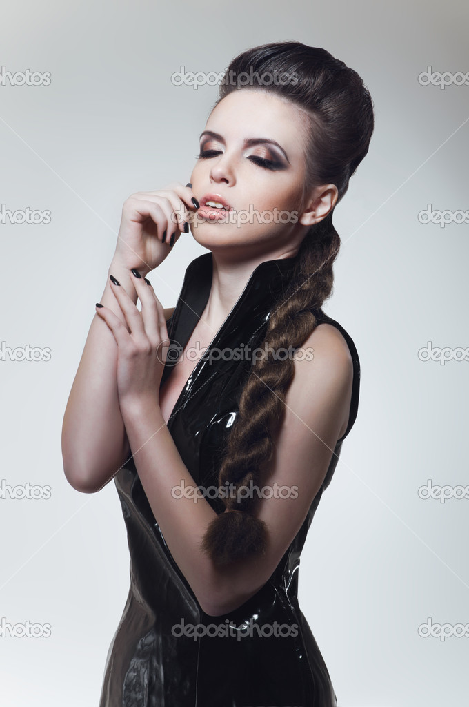 Young brunette woman in black fetish dress — Stock Photo #10339754