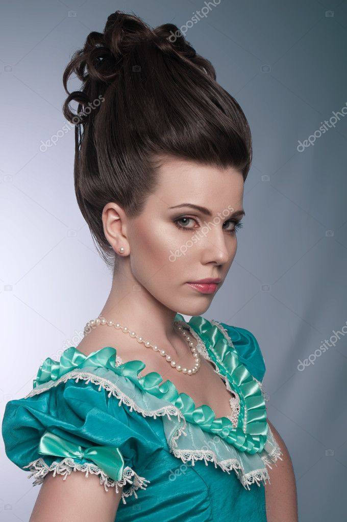 Portrait of old fashioned girl in cyan dress — Stock Photo #10398564
