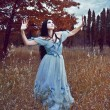Gothic girl outdoor in blue dress autumn field — Stock Photo