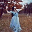 Gothic girl outdoor in blue dress autumn field - Zdjęcie stockowe