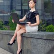 Young woman with laptop — Stock Photo #10423664