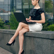 Young woman sitting with laptop — Stock Photo #10423665