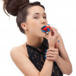 Portrait of young woman with strawberry over white — Stock Photo