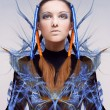 Futuristic girl with blue and orange energy flows. Art concept — Stock Photo
