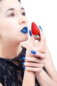 Young woman with strawberry and blue nails and lips isolated on white backgound — Stok fotoğraf