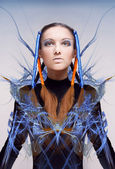 Futuristic girl with blue and orange energy flows. Art concept — Photo