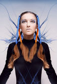 Futuristic girl with blue and orange energy flows. Art concept — Stok fotoğraf