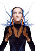Futuristic girl with blue and orange energy flows. Art concept — Stock fotografie