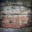 Torn metal plate on wooden background — Stock Photo