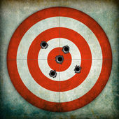 Target with bullet holes — Stockfoto