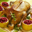 Christmas roast goose with apples stuffed with cranberries — Stock Photo #7976400