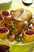 Christmas roast goose with apples stuffed with cranberries — Stock Photo