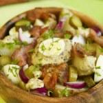 Warm potato salad with bacon — Stock Photo