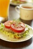 Sandwich with baked ham, lettuce and tomato — Stock Photo