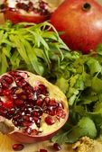 Pomegranate and herbs — Stock Photo