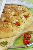 Focaccia bread with cherry tomatoes, rosemary and salt — Stock Photo