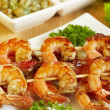Shrimp-grill on wooden sticks — Stock Photo