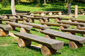 Outdoor wood benches on green lawn — Foto Stock