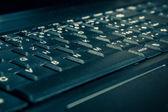 Close up of toned laptop keyboard — Stock Photo
