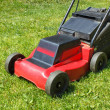 Lawnmower on grass — Stock Photo #10726150