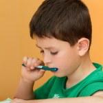 Boy doing homework from school in workbook — Stock Photo