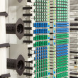 Stock Photo: Fiber optic rack with high density of blue and green SC connectors