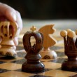 Chess play with focus to black king in front — Stock Photo