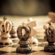 Chess with focus to black king in front — Stock Photo