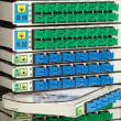 Fiber optic rack with high density of blue and green SC connectors — Stock Photo