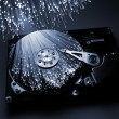 Royalty-Free Stock Photo: Fibre optical and computer harddisk