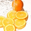 Water splash and orange — Stock Photo