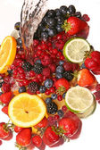 Water splash and fruits — Stock Photo