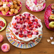 Variety of sweet treats on a table - Stock Photo
