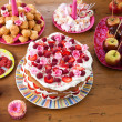 Table with sweet treats - Stock Photo