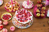 Table with sweet treats — Stock Photo