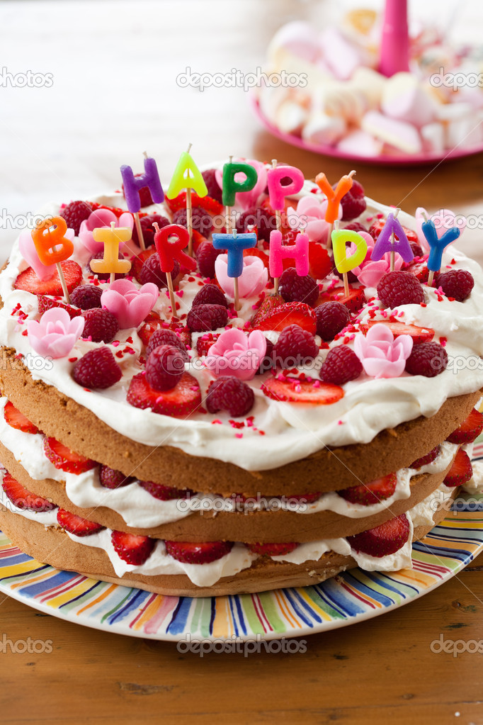Delicious cake with candy letters on top that read happy birthday — Stock Photo #9069832