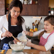 Mother and Daughter together in kitchen — Stock Photo