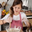 Young girl in the kitchen — Stock Photo