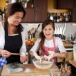 Stock Photo: Mother and Daughter together in kitchen